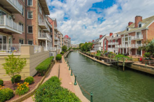 View of the canal in Port Liberte with condo buildings on either side of the water.